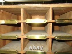 1950's mail casing unit with 350 2x4 cubby holes, notes from the mail clerk