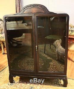 Antique 50 Tall Wooden Display Cabinet with Glass Doors & Decorative Top