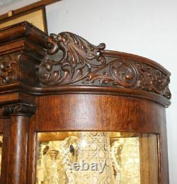 Antique Fancy Curved Glass Oak China Cabinet with carved Lions and claw feet