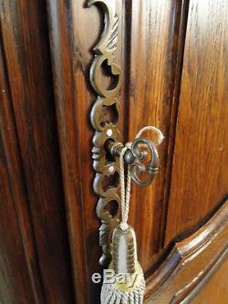 Antique French Country Armoire Tall Narrow Dark Oak Carved Key Shell