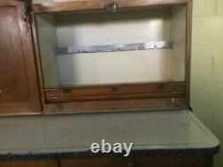 Antique Hoosier Cabinet By McDougall With Pullout Porcelain Tabletop