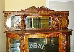 Antique Oak Bowed Glass China Cabinet with Claw Feet and Full Bodied Griffins