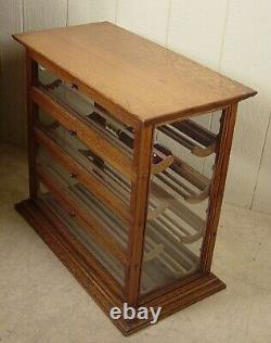 Antique Oak Ribbon Cabinet