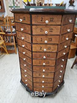 Antique Octagon Rotating Hardware Store Cabinet 88 drawers