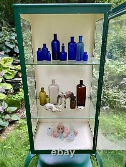 Gorgeous turn of the century era medical/apothecary cabinet with Queen Anne legs