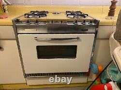 Midcentury American Kitchen AVCO steel cabinets, Kenmore Stove, and breadbox