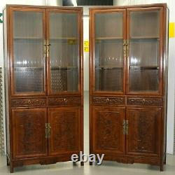 Pair Of Chinese Walnut Cabinets With Glass Doors And Carved Details