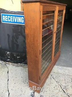 Pretty c1930-40 mahogany ledger cabinet old glass solid 54 h x 56.5 w x 9deep