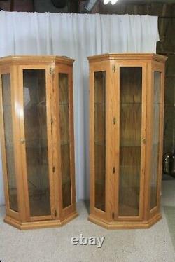 Set of two matching corner curio cabinets golden oak glass shelves 78 tall