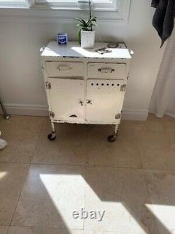 Vintage White Metal Rolling Medicine Cabinet